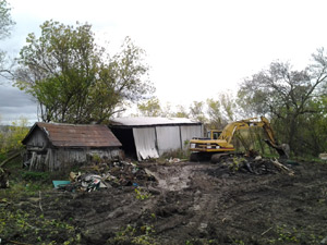 Photo of excavator demolishing a barn