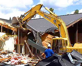 Photo of a excavator demolishing a building