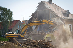 Photo of a contractor demolishing a house