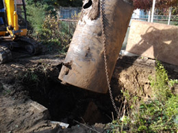 Photo of excavator removing an Underground Storage Tank