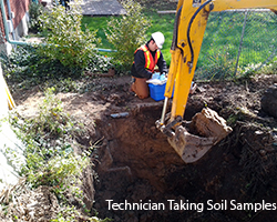 Photo of Eco Demolition technician taking soil samples after removal of Underground Storage Tank